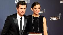 French actor Guillaume Canet (L) and his partner French actress Marion Cotillard pose as they arrive for the 40th edition of the Cesar Awards ceremony