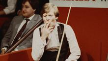 DIFFERENT CLOTH: Alex Higgin smoking a cigarette during his 1983 World Championship semifinal defeat to rival Steve Davis. Photo by Adrian Murrell/Getty Images