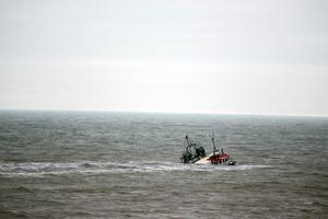 The boat, called the Atlantic Osprey, could be seen half submerged in the sea south of Balbriggan. Photo: Mark Condren