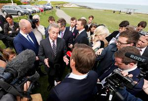 Nigel Farage speaks to journalists after resigning as leader of the United Kingdom Independence Party (UKIP) after failing to secure a seat in parliament during a news conference in Broadstairs, on the south coast of Britain, May 8, 2015. REUTERS/Suzanne Plunkett