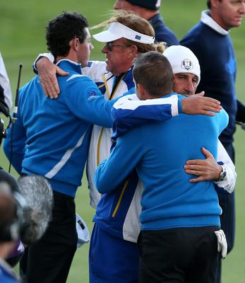 Europe's Rory McIlroy (left) is congratulated by vice captain Miguel Angel Jimenez (second left) and Sergio Garcia is congratulated by vice captain Jose Maria Olazabal (left) after their foursomes matches during day one of the 40th Ryder Cup at Gleneagles Golf Course, Perthshire