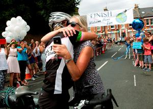 Tom Davies, 19, who claims to be the youngest person to have cycled around the world,  is greeted by his mother Alison as he arrives back in London to his home in Battersea, on the final leg of his epic 18,000-mile journey. PRESS ASSOCIATION Photo. Picture date: Sunday August 9, 2015. Battling wind, rain and snow, he has notched up 100 miles of cycling a day to complete his trip, and raised nearly ?50,000 for charities. See PA story CHARITY Cyclist. Photo credit should read: Yui Mok/PA Wire