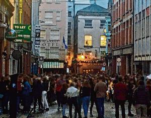 'Too-close socialising': A screengrab from video showing people, in Dublin on Saturday evening as lockdown restrictions started to ease. Photo: PA