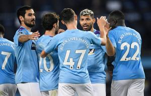 Manchester City players celebrate. Photo: Peter Powell/Pool via Reuters