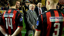The President of Ireland Michael D. Higgins meets members of the Bohemians team before the game.