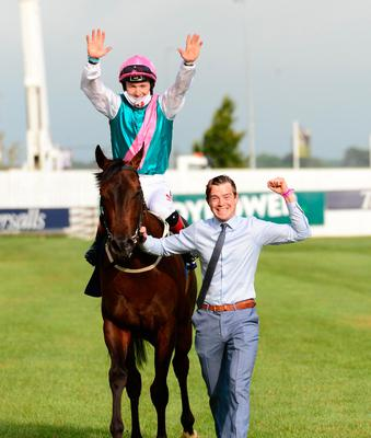 Siskin and Colin Keane, with groom Dan MacGrianna, after winning the 2,000 Guineas at the Curragh yesterday. Photo: PA Wire