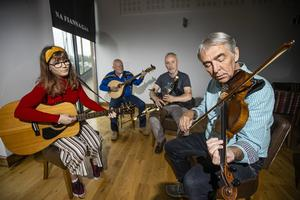 Members of Na Fianna Gaa club playing traditional music at their clubhouse. (L-R) Órna Ní Dhálaigh, Tom Flaherty, Gearóid Ó Donnchadha and Ger Flanagan Pic: Mark Condren