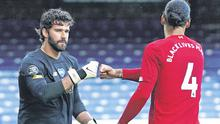 Alisson Becker and Virgil Van Dijk have added steel and style to Liverpool's defence. Photo: Jon Super/Reuters