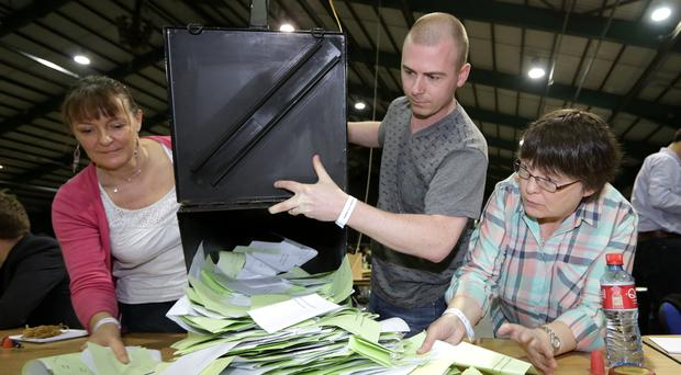 The ballot boxes in the Marriage Equality Referendum and the  Presidential Age Referendum  pictured being opened in the RDS Simmonscourt . Pic Frank Mc Grath