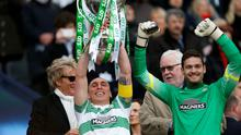 Celtic's Scott Brown and Craig Gordon celebrates with Rod Stewart and the trophy after winning the Scottish League Cup Final.