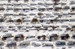 Homes are covered in snow in West Seneca, New York. The Buffalo area found itself buried under as much as five feet of snow Wednesday, with another lake-effect storm expected to bring two to three more feet by late Thursday.