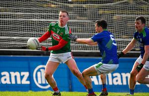 Ryan O'Donoghue of Mayo in action against Paul Murphy and Tom O'Sullivan of Kerry. Photo: Brendan Moran/Sportsfile