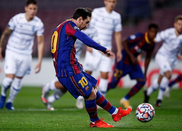 Barcelona's Lionel Messi scores from the penalty spot during the Champions League Group G match against Dynamo Kyiv at Camp Nou
