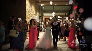 Newlyweds Hana Haka and Tyler Noland exit their wedding reception cheered on by friends and family   Photo: YouTube ALX BMGINC
