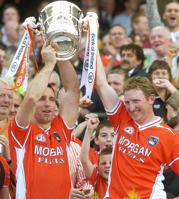 Enda McNulty lifts Sam Maguire with Armagh team-mate Francie Bellew in 2002. Photo: Sportsfile
