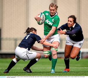 Claire Molloy, Ireland, is tackled by Eilidh Sinclair and Gillian Inglis, right, Scotland. Women's Six Nations Rugby Championship, Scotland v Ireland. Broadwood Stadium, Clyde FC, Glasgow, Scotland. Picture credit: Stephen McCarthy / SPORTSFILE