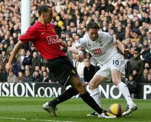 Tottenham's Robbie Keane (R) vies with Manchester United's Rio Ferdinand (L) during their Premiership match at home to Tottenham Hotspur at White Hart Lane stadium, 02 February 2008. AFP PHOTO/CARL DE SOUZA Mobile and website use of domestic English football pictures are subject to obtaining a Photographic End User Licence from Football DataCo Ltd Tel : +44 (0) 207 864 9121 or e-mail accreditations@football-dataco.com - applies to Premier and Football League matches. (Photo credit should read CARL DE SOUZA/AFP/Getty Images)