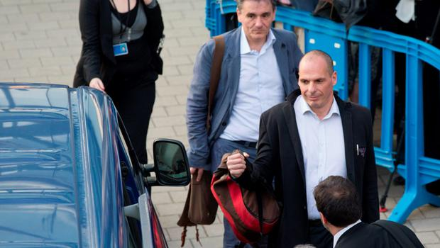 Greek Finance Minister Yanis Varoufakis (front) and Chief Economics Spokesman of the Government of Greece Euclid Tsakalotos leave a Eurozone finance ministers emergency meeting in Brussels, Belgium, June 24, 2015. Greek Prime Minister Alexis Tsipras wrestled with creditors demanding changes to his proposed tax and reform plans on Wednesday in a last-minute race to clinch a deal to which euro zone finance ministers could late agree. REUTERS/Philippe Wojazer