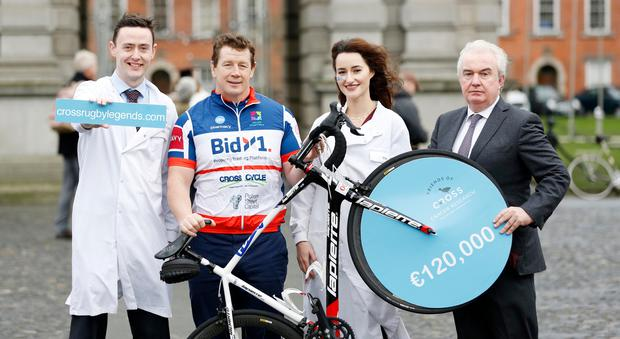 Former Ireland and Lions rugby player Paul Wallace and CEO of BidX1 Stephen McCarthy (far right) celebrate the donation of €120,000 to The Trinity St James's Cancer Institute along with researchers Dr Maria Davern and Dr Noel Edward Donlon. Photograph: Sasko Lazarov / Photocall Ireland