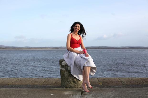 On the dock of the bay: Writer Kathy Donaghy at Mountcharles pier in Donegal. Photo: Lorcan Doherty