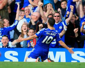 Eden Hazard celebrates after scoring what proved to be the winning goal against Manchester United yesterday