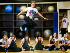 05/05/2015 NO REPRO FEE, MAXWELLS DUBLIN. Pic shows: Brendan Dorris with dancers from the Riverdance Troupe. Dancers from the Riverdance Troupe mark World Pulmonary Hypertension Day at the 1Escape Gym in Smithfield. The dancers were working out preparing for their return to the Gaiety Theatre for their annual summer season while 'Getting Breathless for Pulmonary Hypertension' (PH).? World PH Day (5 May) is recognised across the globe and sees activities take place all over the world to highlight awareness of this devastating disease. PIC: NO FEE, MAXWELLS.