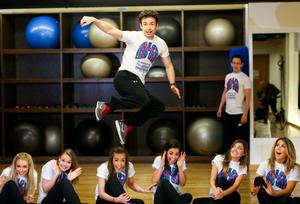 05/05/2015 NO REPRO FEE, MAXWELLS DUBLIN. Pic shows: Padraic Moyles with dancers from the Riverdance Troupe. Dancers from the Riverdance Troupe mark World Pulmonary Hypertension Day at the 1Escape Gym in Smithfield. The dancers were working out preparing for their return to the Gaiety Theatre for their annual summer season while 'Getting Breathless for Pulmonary Hypertension' (PH).? World PH Day (5 May) is recognised across the globe and sees activities take place all over the world to highlight awareness of this devastating disease. PIC: NO FEE, MAXWELLS.