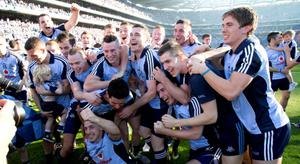 Dubs stars celebrate after getting their hands on Sam Maguire. Photo: Caroline Quinn
