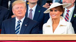 US President Donald Trump (L) and US First Lady Melania Trump attend an event to commemorate the 75th anniversary of the D-Day landings, in Portsmouth, southern England, on June 5, 2019