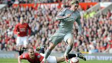 Fernando Torres leaves Nemanja Vidic in his wake during the 4-1 victory at Old Trafford in 2009