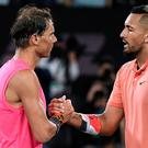 Spain's Rafael Nadal, left, is congratulated by Australia's Nick Kyrgios after winning their fourth round singles match at the Australian Open tennis championship in Melbourne, Australia on Monday. AP Photo/Andy Brownbill)