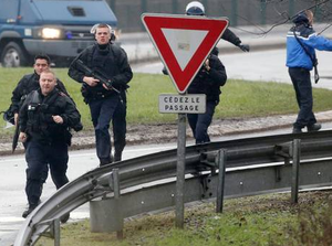 Members of the French intervention gendarme forces arrive at the scene of a hostage taking at an industrial zone in Dammartin-en-Goele, northeast of Paris