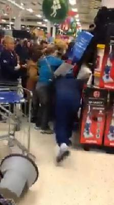 Separately, a man is filmed barging into a group of shoppers and throwing a trolley and a step-stool aside to grab a cut-price TV from the supermarket shelves.