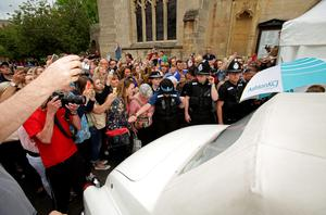 Members of the public surround the car carrying former Coronation Street actress Michelle Keegan as it arrives at St Mary's Church in Bury St Edmunds, Suffolk, ahead of her wedding to The Only Way Is Essex star Mark Wright.  Yui Mok/PA Wire