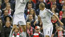 Real Madrid's Cristiano Ronaldo (L) celebrates after scoring a goal against Liverpool during their Champions League Group B soccer match at Anfield in Liverpool, northern England October 22, 2014.    REUTERS/Phil Noble (BRITAIN  - Tags: SOCCER SPORT)