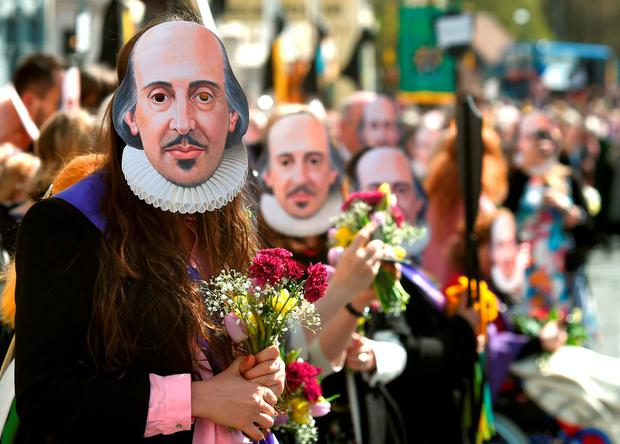 Members of the public wear William Shakespeare masks during the parade marking 400 years since the death of the playwright in Stratford-upon-Avon Credit: Joe Giddens/PA Wire