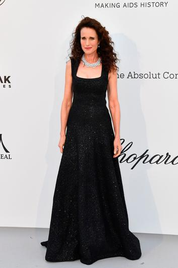 US actress Andie MacDowell poses as she arrives on May 23, 2019 for the amfAR 26th Annual Cinema Against AIDS gala at the Hotel du Cap-Eden-Roc in Cap d'Antibes, southern France, on the sidelines of the 72nd Cannes Film Festival. (Photo by Alberto PIZZOLI / AFP)