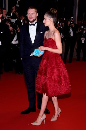 """Jack Reynor and Madeline Mulqueen depart the """"Macbeth"""" Premiere during the 68th annual Cannes Film Festival on May 23, 2015 in Cannes, France.  (Photo by Clemens Bilan/Getty Images)"""