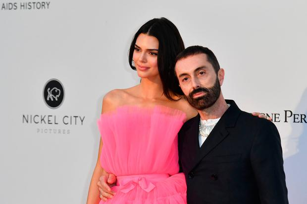 US model Kendall Jenner (L) and italian fashion designer Giambattista Valli pose as they arrive on May 23, 2019 at the amfAR 26th Annual Cinema Against AIDS gala at the Hotel du Cap-Eden-Roc in Cap d'Antibes, southern France
