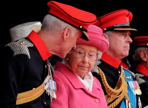 RICHMOND, ENGLAND - MAY 02:  Queen Elizabeth II attends the amalgamation parade of The Queen's Royal Lancers and 9th/12th lancers (Prince of Wales's) at Richmond Castle on May 2, 2015 in Richmond, England. The Queen took the Royal Salute in the historic castle grounds before inspecting and addressing the parade of the newly formed The Royal Lancers before the Regiment marched past the saluting dias.  (Photo by Ian Forsyth/Getty Images)