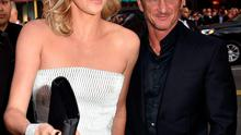 """HOLLYWOOD, CA - MAY 07:  Actress Charlize Theron (L) and actor Sean Penn attend the premiere of Warner Bros. Pictures' """"Mad Max: Fury Road"""" at TCL Chinese Theatre on May 7, 2015 in Hollywood, California.  (Photo by Kevin Winter/Getty Images)"""