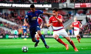 Marcus Rashford of Manchester United (L) is put under pressure from Bernardo Espinosa of Middlesbrough. Photo by Stu Forster/Getty Images