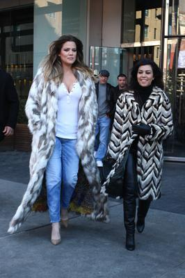 Kim Kardashian and her sisters, Kourtney and Khloe Kardashian leave their hotel