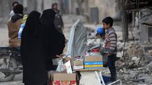 Women shop at a street vendor in the northern Syrian town of al-Bab, Syria March 6, 2017. REUTERS/Khalil Ashawi