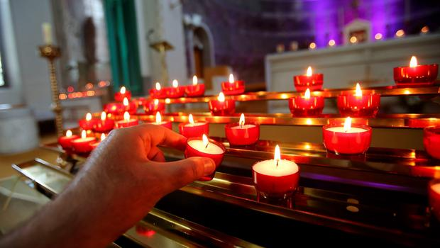 Candles are lit in memory of the victims of the Berkeley balcony collapse at Our Lady of Perpetual Succour church in Foxrock, Dublin. Niall Carson/PA Wire