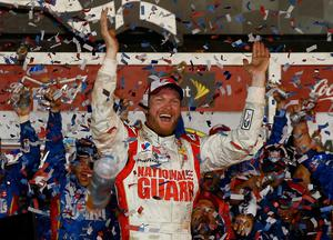 Dale Earnhardt Jr., driver of the #88 National Guard Chevrolet, celebrates in Victory Lane after winning during the NASCAR Sprint Cup Series Daytona 500 at Daytona International Speedway