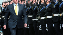 Taoiseach Enda Kenny inspects a Guard of Honour drawn from the LÉ James Joyce's company before the naming and commissioning ceremony for the Irish naval vessel in Dún Laoghaire Photo: Frank McGrath