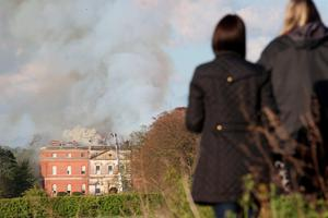 Firefighters battle a blaze at Clandon Park, a Palladian mansion built in the 1720s, after a fire broke out at the National Trust property near Guildford, Surrey. Photo: Steve Parsons/PA Wire