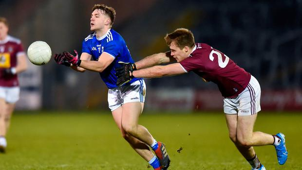 Oisin Pearson of Cavan in action against Paddy Holloway of Westmeath. Photo: Oliver McVeigh/Sportsfile