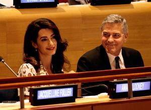 Actor George Clooney (R) and wife Amal Clooney attend a Leaders Summit for Refugees during the United Nations 71st session of the General Debate at the United Nations General Assembly on September 20, 2016 in New York, New York. (Photo by Peter Foley - Pool/Getty Images)